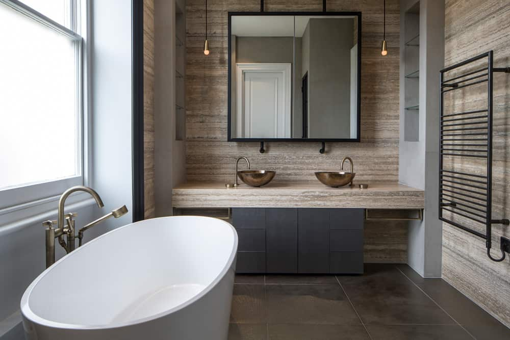 contemporary bathroom with marble vanity and oval bath