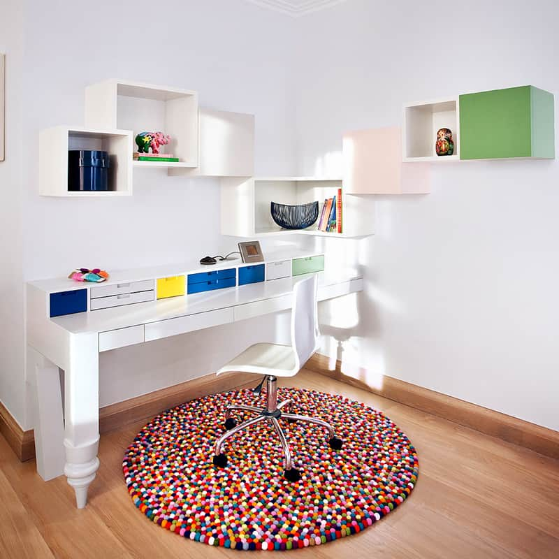 bespoke desk and shelving with pom pom rug in children's bedroom