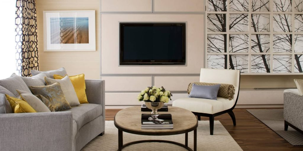 contemporary living room with hints of yellow and gold