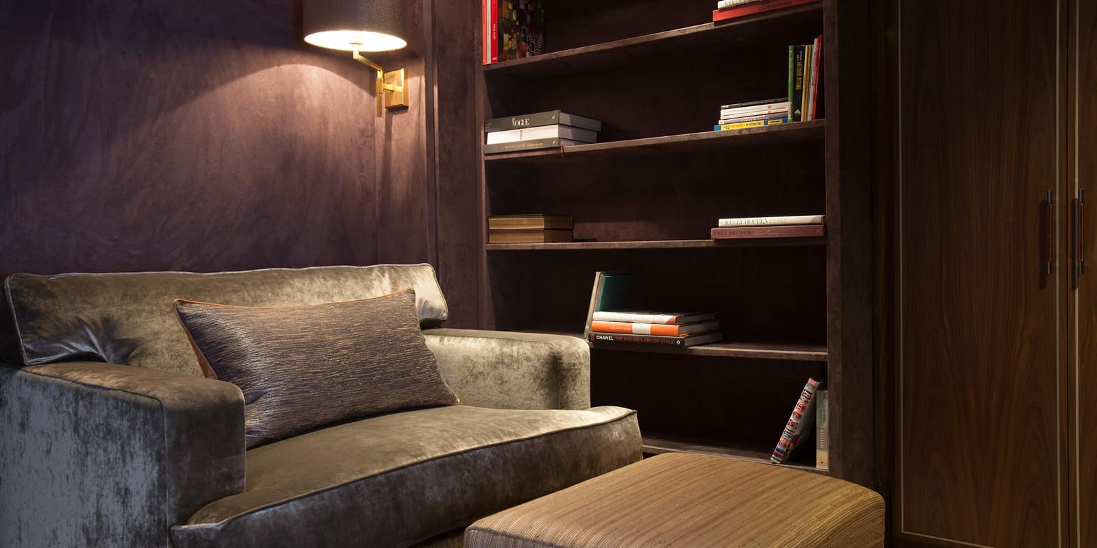 Cozy reading corner and wooden shelves