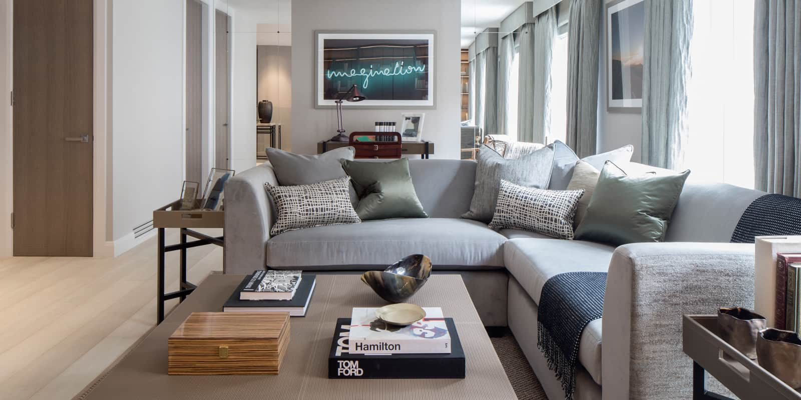 modern living room in neutral colour palette with grey sofa and large coffee table