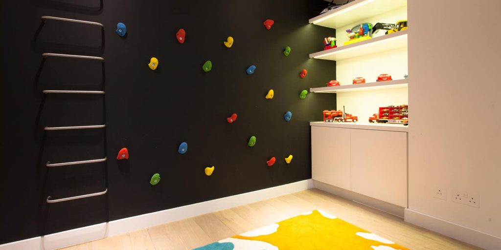 Children's play room with a climbing wall