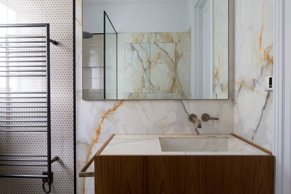 The Vanity Basin In This Industrial Bathroom Is Constructed From Calacatta  Marble Encased In A Teak