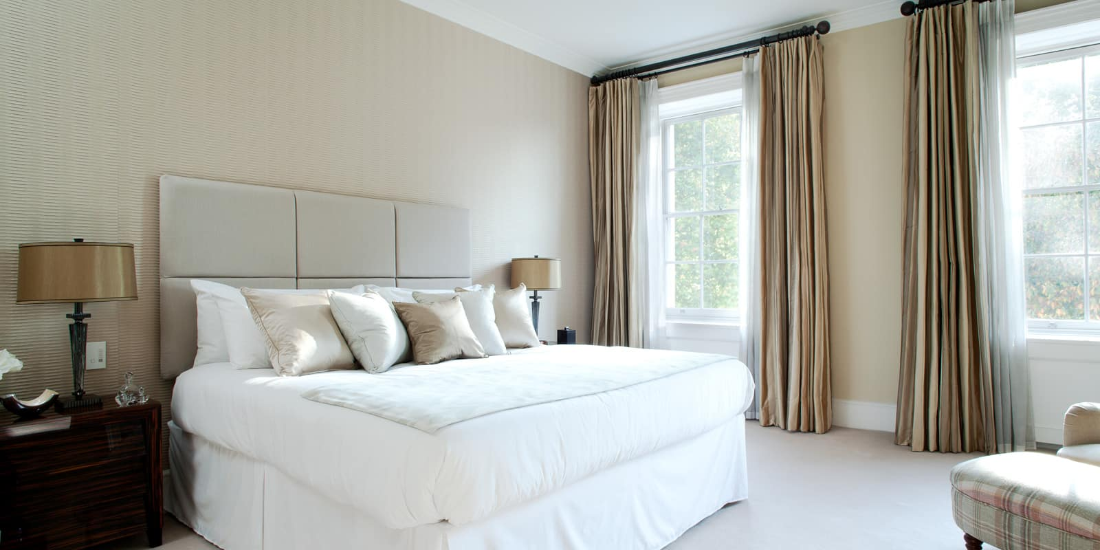 elegant bedroom in white and gold with textures walls