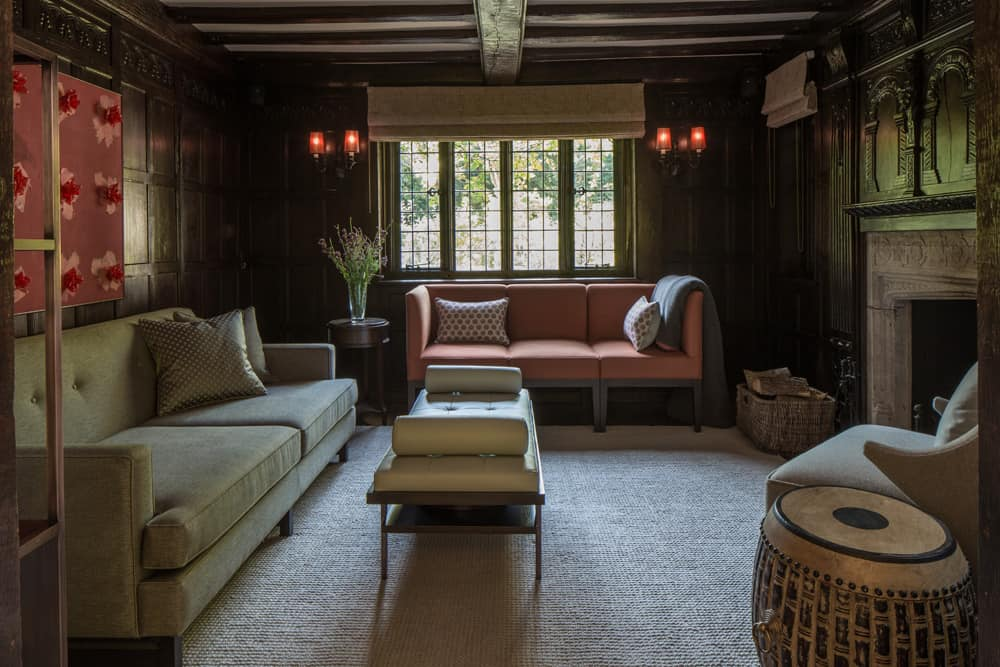 snug or reading room with terracotta three seat sofa and drum style side table