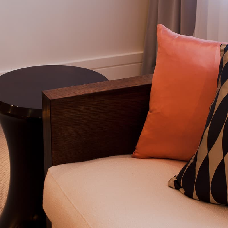 luxurious soft furnishings in amber with dark wood side table
