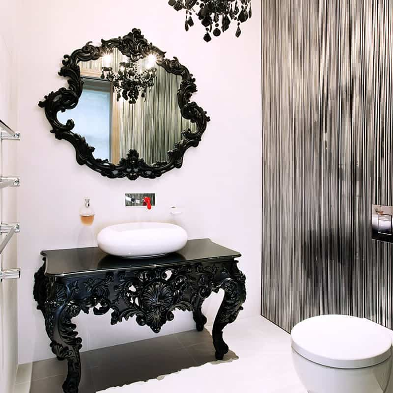 modern black, white and grey bathroom with chandelier