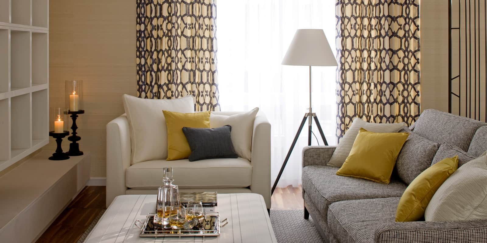 modern living room in neutral colour palette of grey, which and gold