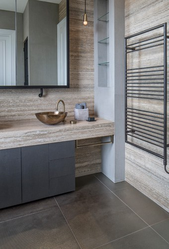 vintage brass sanitaryware adds a sophisticated industrial feel to this contemporary bathroom