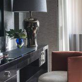 Broad walk guest bedroom decor with orange chair