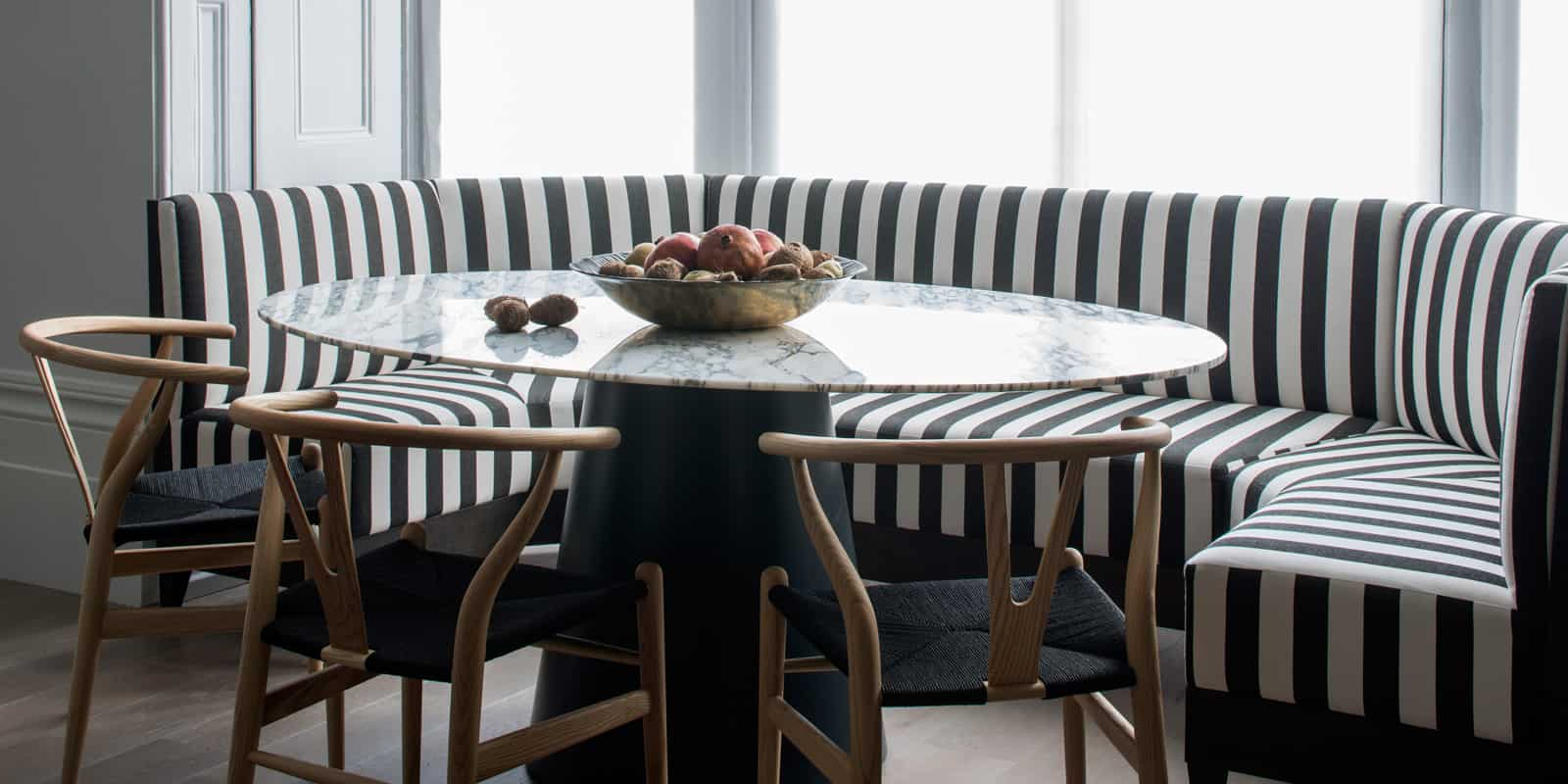 black and white banquette seating in bay window