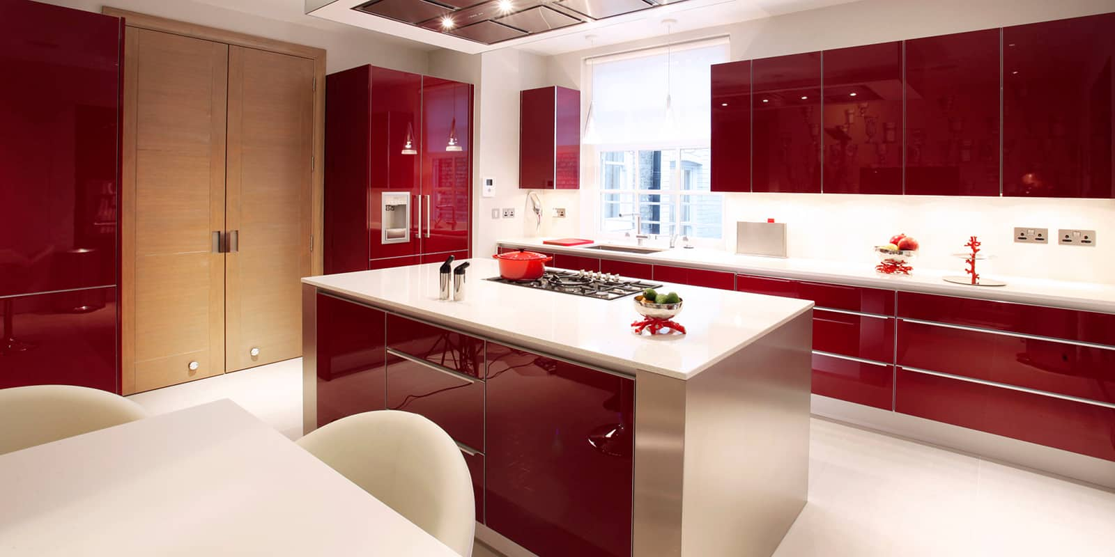 Large modern kitchen with red cupboards