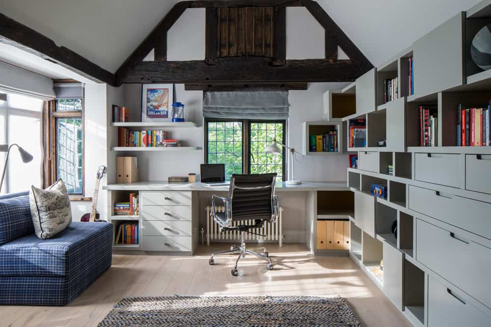 boys grey bedroom with desk and built-in joinery and storage space