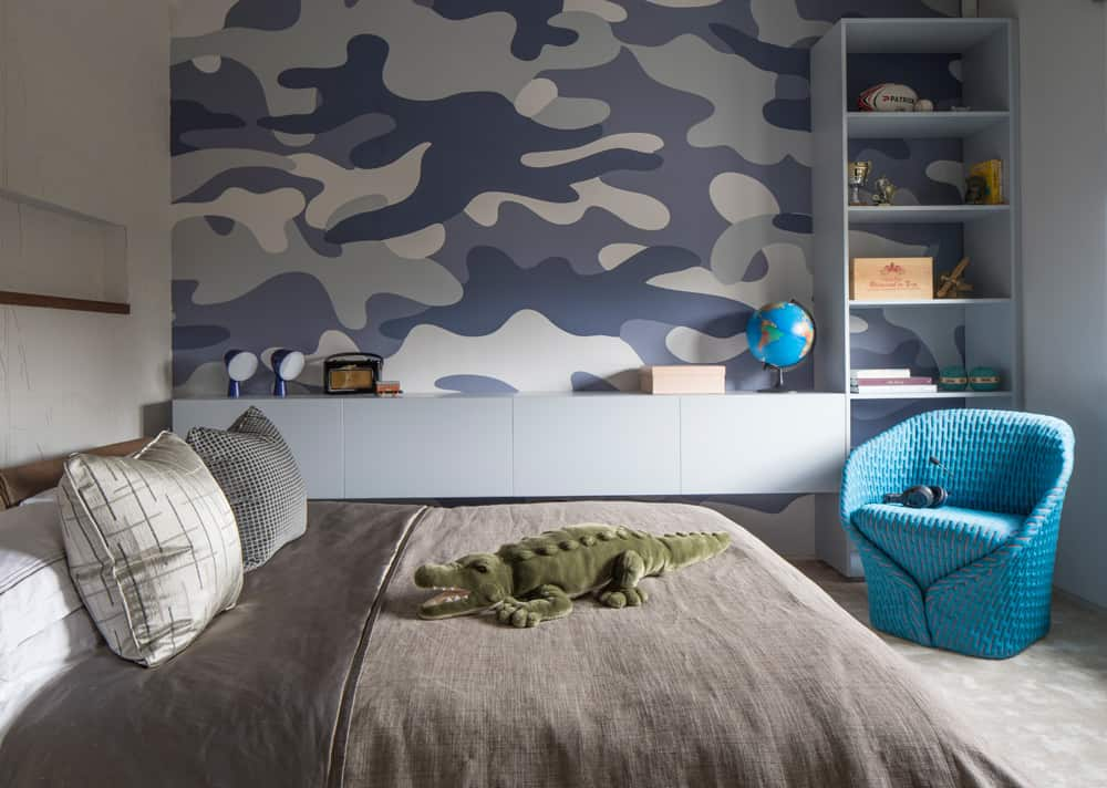 children's blue and grey bedroom with patterned wallpaper