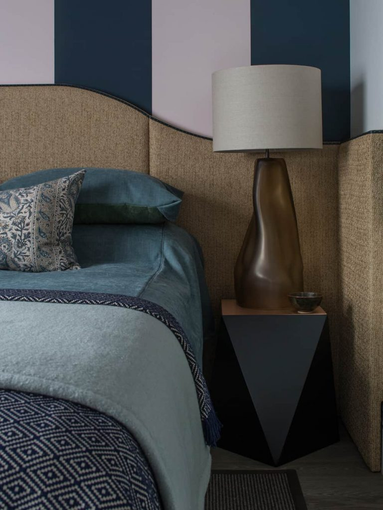 textured wrap-around headboard for holiday house london by roselind wilson design