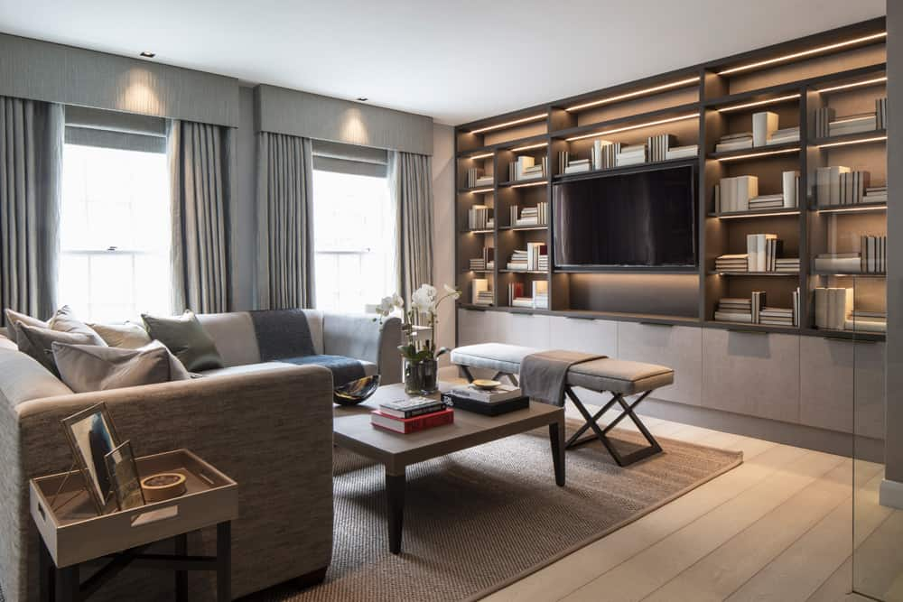 the luxurious living room with neutral colour palette and built in joinery in eaton mews north by roselind wilson design