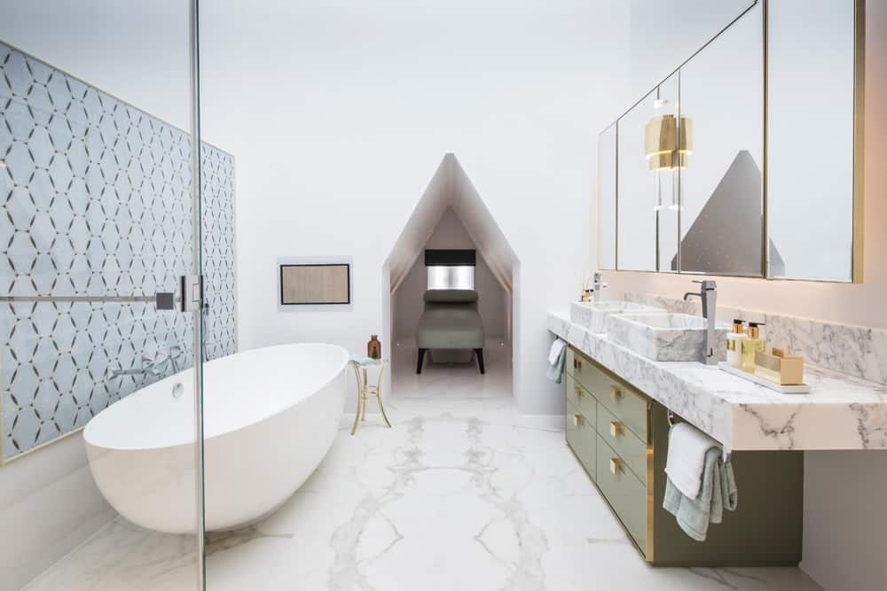 luxury contemporary bathroom with marble vanity and daybed in alcove