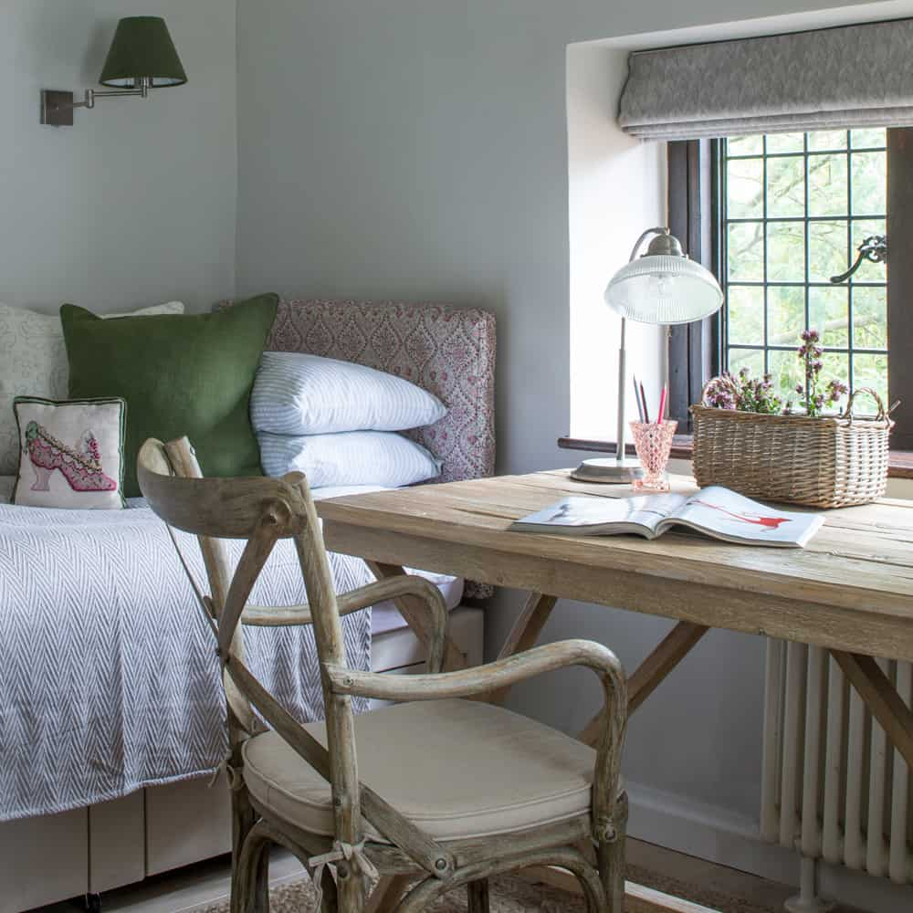 rustic contemporary bedroom with floral patterns and oak desk