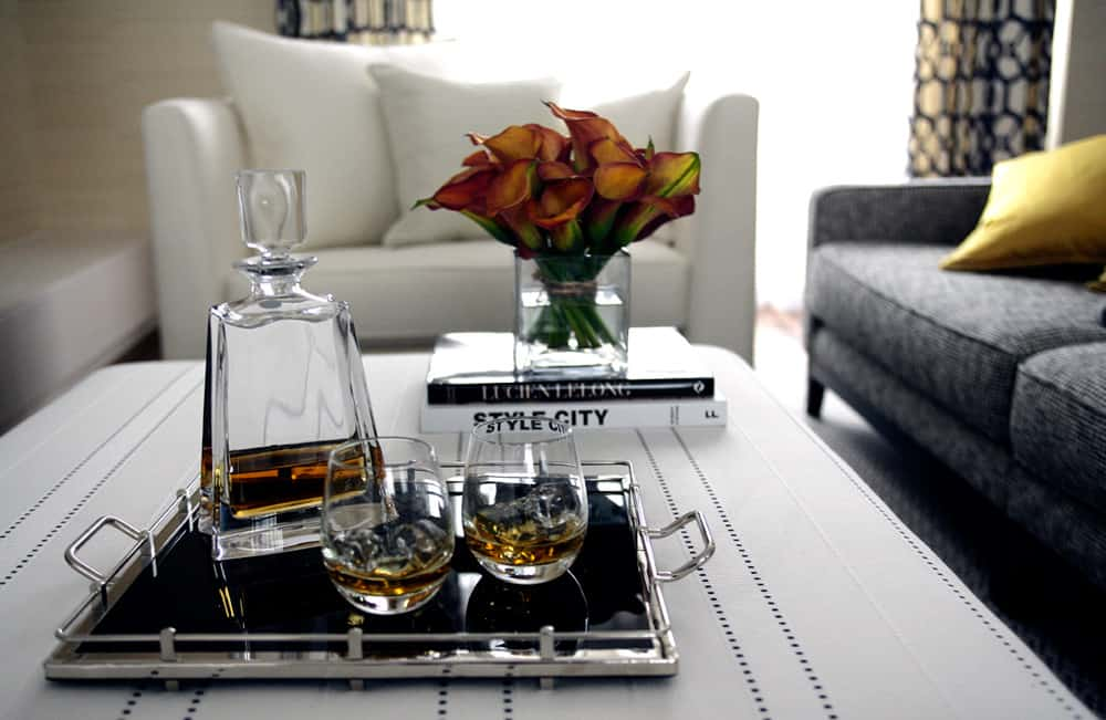 short stem roses with crystal tumblers and silver accessories in this modern living room