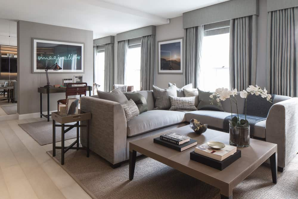 single flower bouquets of orchids are a delicate addition to this grey contemporary living room