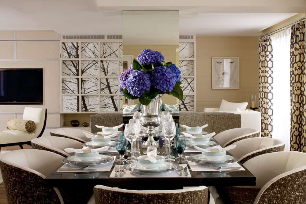 blue and violet hydrangea are a striking centre piece on this lavish dining table