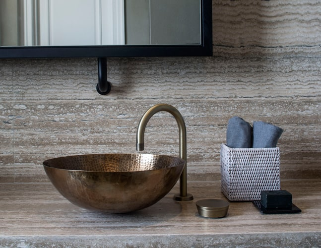 wabi-sabi decor tips using a handmade metal basin