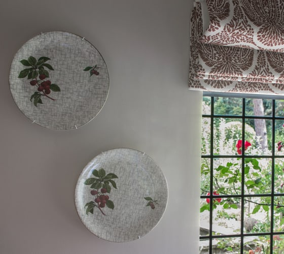 wabi-sabi decor tips using an existing decorative plate collection