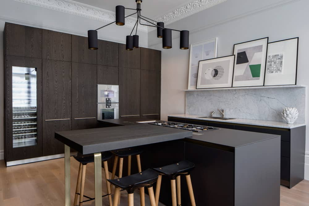 contemporary industrial kitchen with black brown cabinetry, Bulthaup kitchen island and marble ledge displaying abstract artwork by roselind wilson design