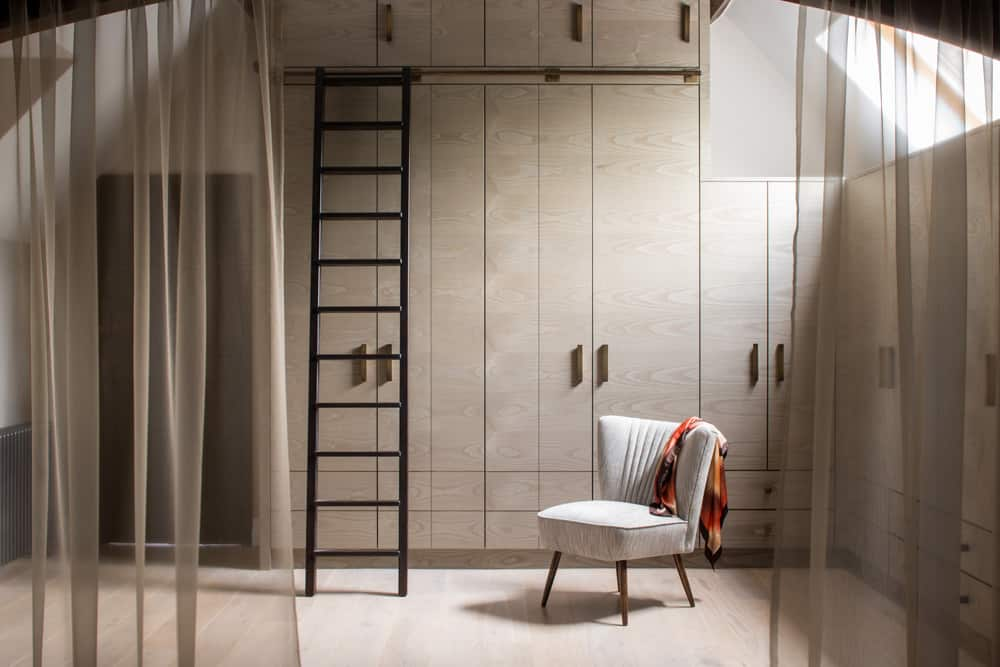 clever storage bespoke dressing room joinery by roselind wilson design