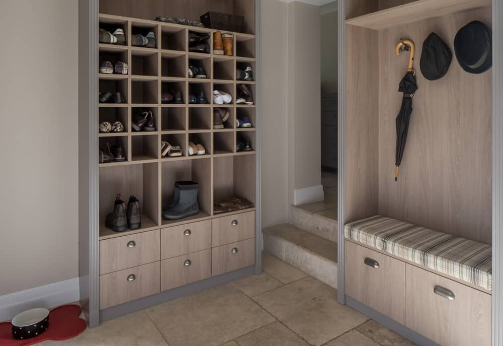 boot room with a combination of cubby holes and closed-in drawers or cupboards by roselind wilson design