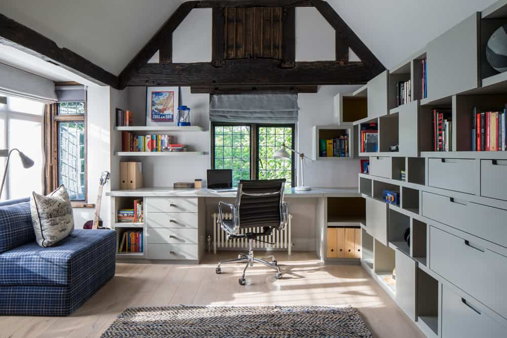 full length desk and bespoke grey joinery and storage in a boys bedroom by roselind wilson design
