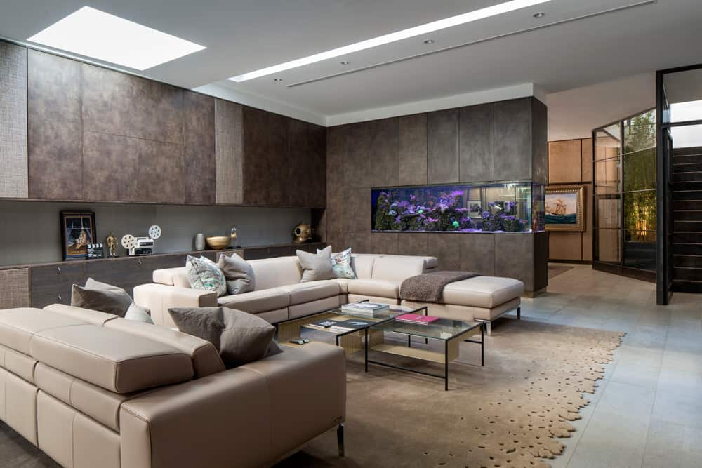bespoke textured joinery in a family entertaining room and home cinema by roselind wilson design