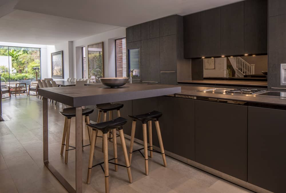 bespoke black brown kitchen cabinetry and kitchen island with stools by roselind wilson design