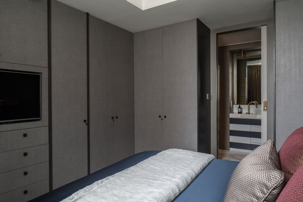 full-height and wall-to-wall bespoke joinery and storage space in a master bedroom by roselind wilson design