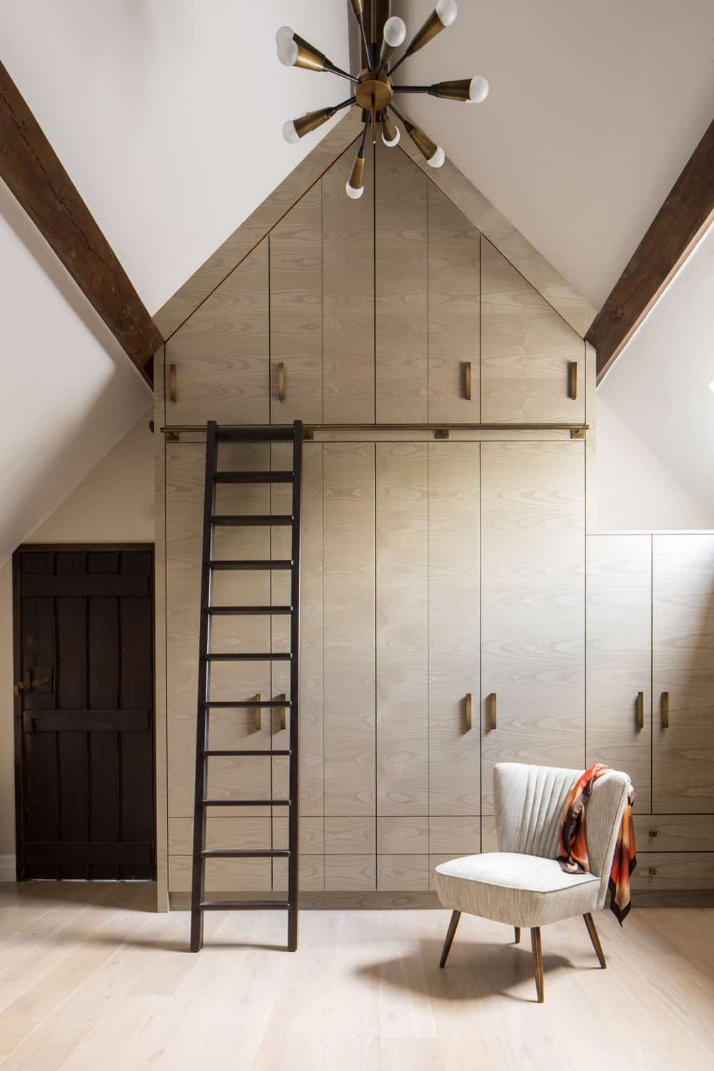 bespoke full-height joinery and storage with metal ladder by roselind wilson design