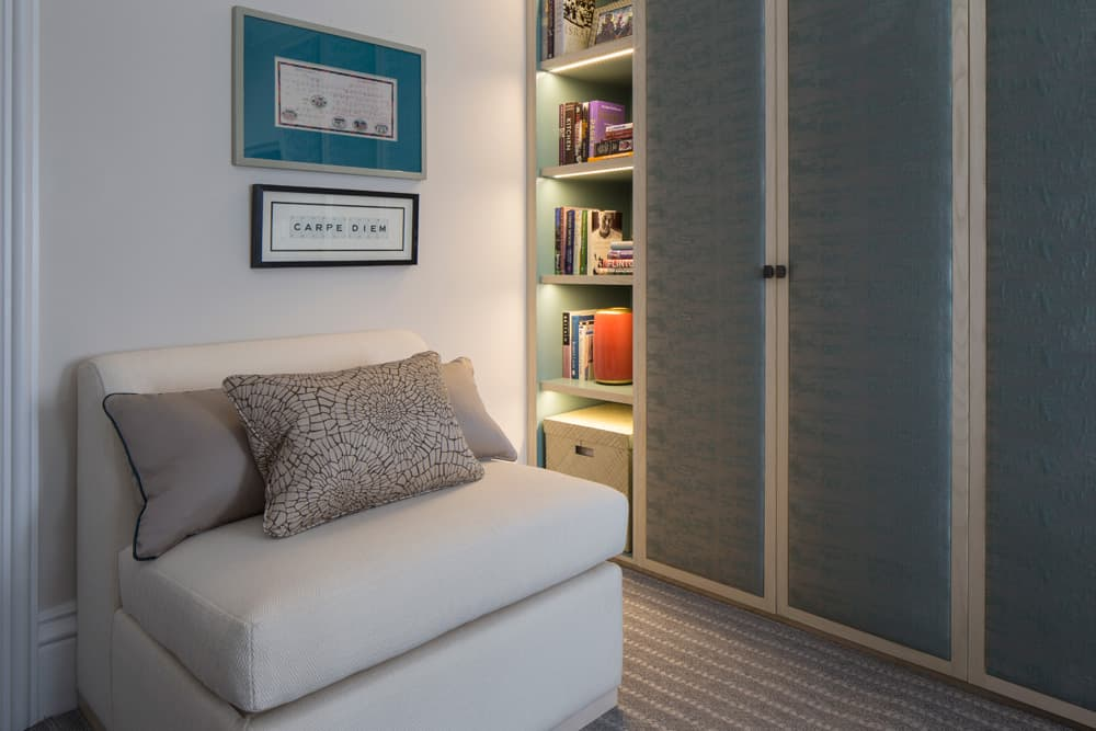 bespoke joinery with a combination of open and closed storage and a single sofa bed by roselind wilson design