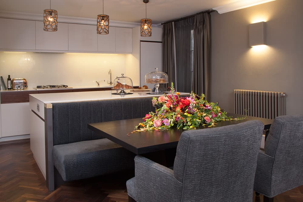 Bespoke banquette-style seating has been built into the kitchen island to create a sociable eating area.