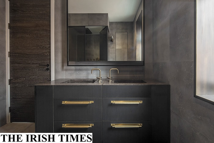 luxury London bathroom with velvet finish limestone walls