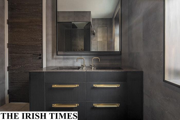 luxury London bathroom with velvet finish limestone walls