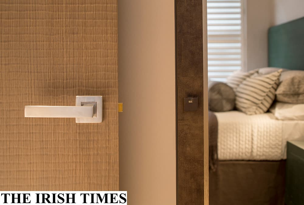 door clad in a leather-effect finish with satin chrome handles