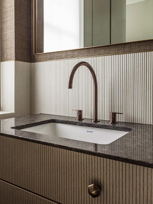 bespoke bathroom vanity with textured door fronts, tiles and wall covering