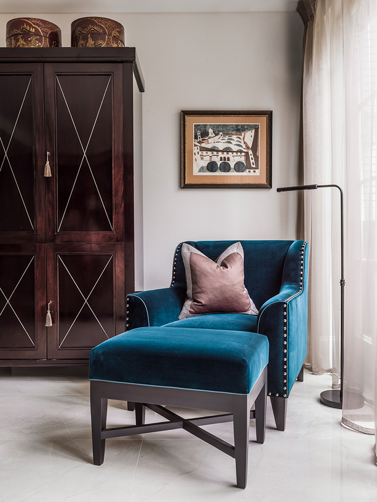 cosy reading corner with deep blue velvet chair