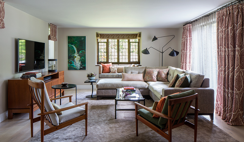 eclectic living room with large L-shaped sofa and bay window seating