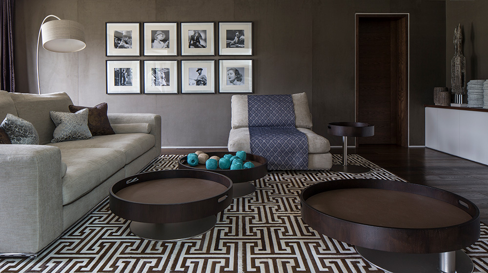 media room with large sofa and modular coffee tables