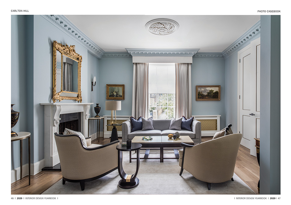 elegant reception room with blue walls and period features
