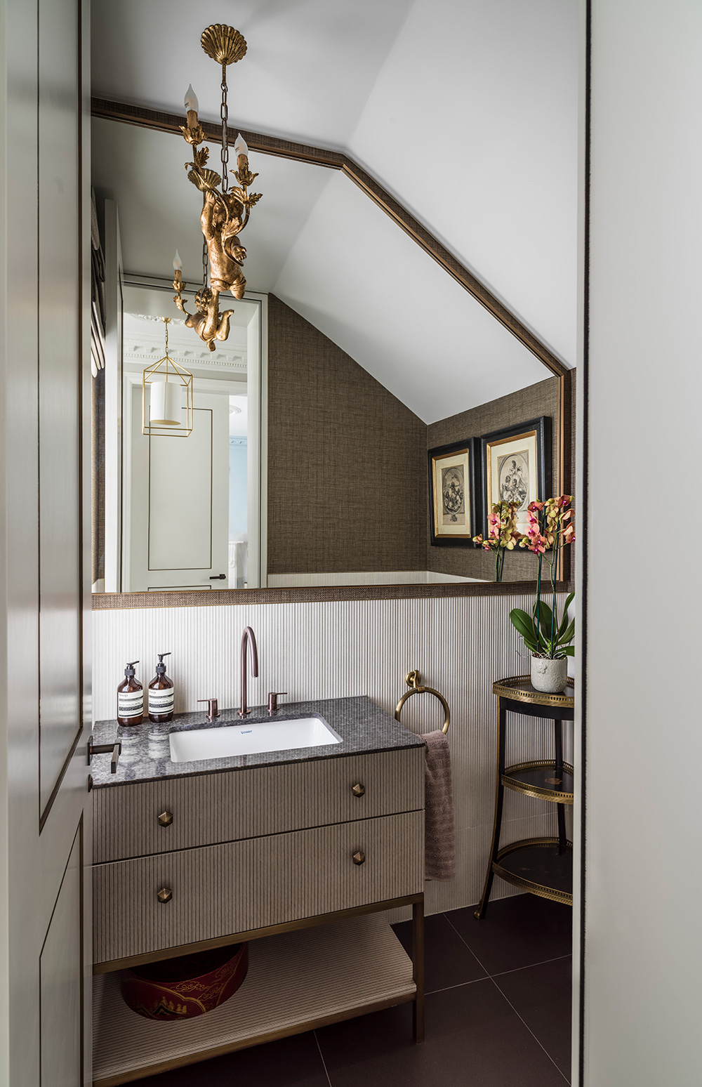 small cloakroom with textured bathroom vanity and cherub chandelier