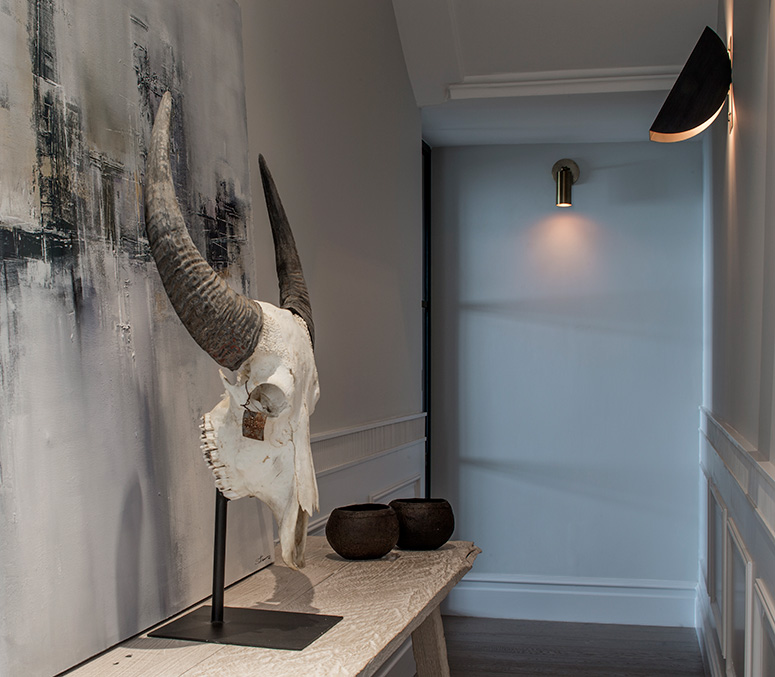 contemporary industrial entrance hallway with skull sculpture