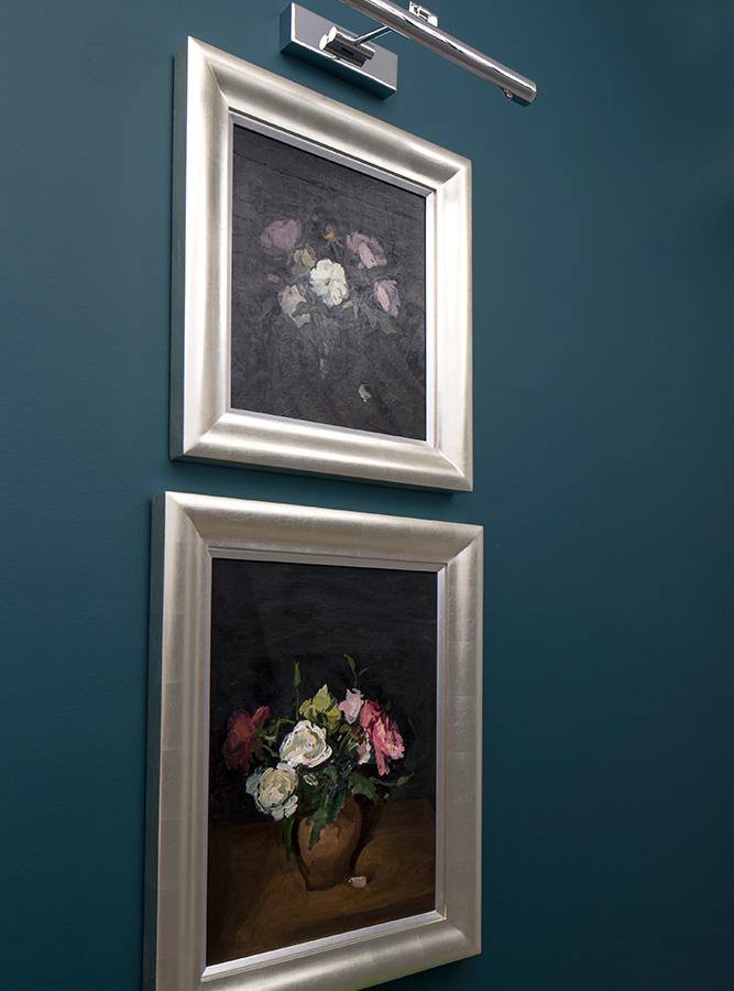 luxury entrance hallway artwork set against dark blue wall