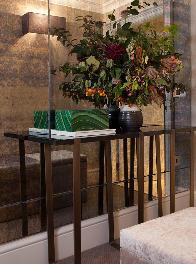 luxury entrance hallway with antique mirror glass and metal console table