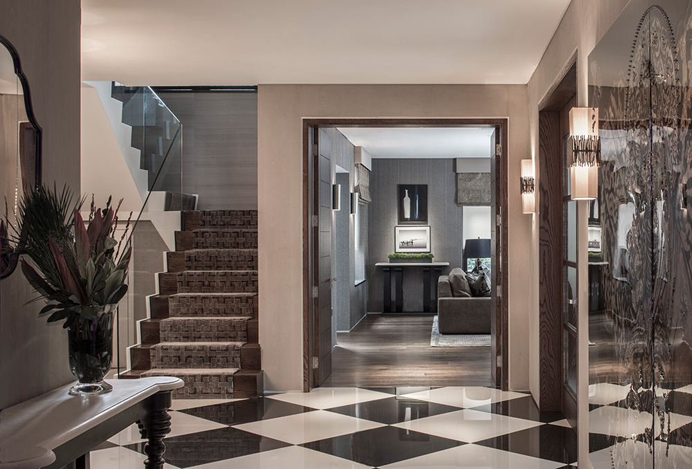 luxury entrance hallway with staircase and chequered flooring